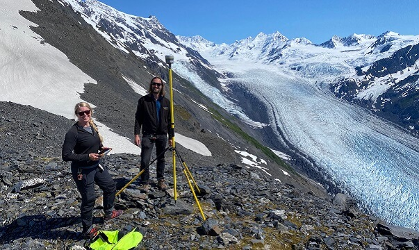 Examining an outcrop near the Yukon border and the Moosehorn Range